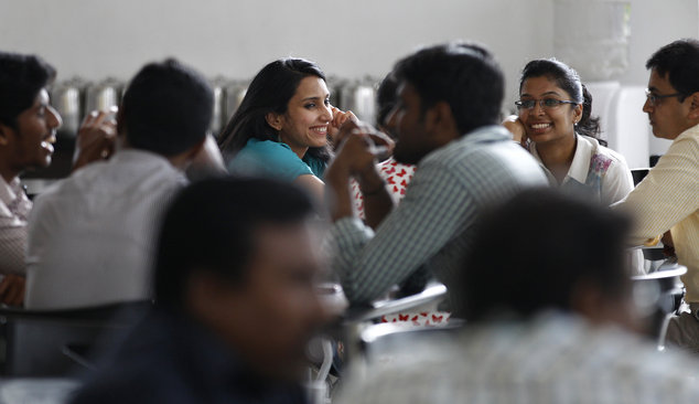 Titan Company employees interact during a break at their corporate office in Bangalore, India, Tuesday, Oct. 28, 2014  (AP Photo/Aijaz Rahi)